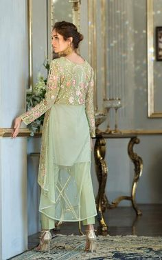 Fully embroidered net tail style shirt with sequence work & pearls embellishment on back of shirt & sleeves. Stylish Dresses For Girls, Wedding Dresses For Girls, Nice Dresses, Awesome Dresses, Fancy Dress Design, Stylish Dress Designs, Designs For Dresses, Pakistani Fashion Party Wear, Pakistani Dresses Casual
