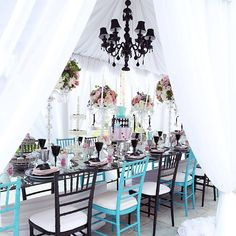 "A fun topsy turvy cake and mismatched chairs would be perfect for an ""Alice in Wonderland"" wedding theme"