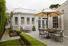 Boxwood around patio along with brick walkway   | Usual House