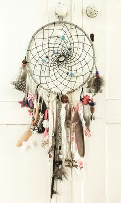 Dreamcatcher with feathers, lace, beads and pretty little things for our babygirl. Handmade by daddy RicoLeka