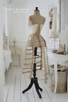 Antique wasp dress form with corset and bustle pannier
