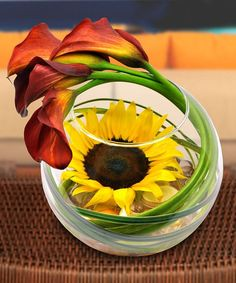 this would look lovely as center pieces! Especially since August is Sunflower's time to bloom! >.<