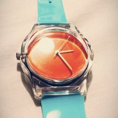 @cupof_tia New watch. Loving the color combo! #may28th #watch #orange #blue