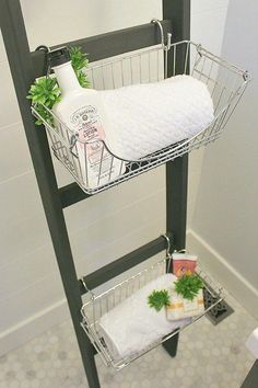 Use a slim wooden ladder, s-hooks, and baskets to squeeze storage out of an awkward corner.