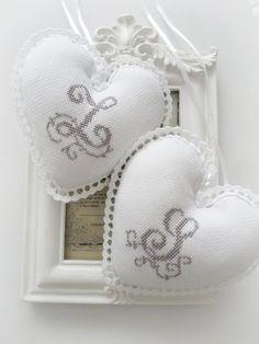 Inspiration - Monogram cross-stitch hearts with crocheted edge.