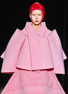 Comme des Garçons, avant garde, pink clothing, red hair, model, futuristic fashion, pink, hairstyle.