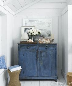 A vintage chest is nestled into a narrow corner in the Hamptons, New York, living room of Ralph Lauren fashion executive Buffy Birrittella. Tour the entire home.
