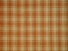Cotton homespun fabric light  brown plaid. Hand wash separately. No chlorine bleach. Line dry.  No yardage is cut until ordered. If ordering more than 1 yard it will come in a continous piece.  This l