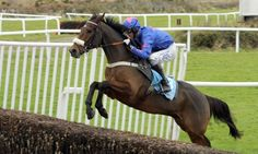 Cue Card winning the 2016 Betfair Chase at Haydock