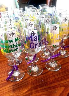 Check out this item in my Etsy shop https://www.etsy.com/listing/208635562/mardi-gras-themed-wine-glasses-new