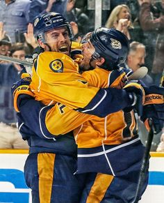 NASHVILLE, TN - DECEMBER 21: Shea Weber #6 and Mike Fisher #12 of the Nashville Predators celebrate a goal against the Montreal Canadiens at...