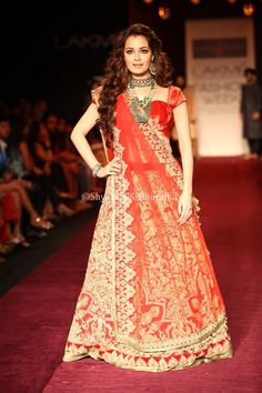 Diya Mirza wears a bridal lehenga in a plush red velvet which combines bold and intricate embroidery, and a Red mesh dupatta with bols velvet applique and mettalic zardozi to complete the look
