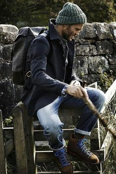 be still my heart, another sailor look. The hat with that pea coat go so well. The boots and jeans fit the look. The bag adds the finishing touch, he looks like he is on his way home from sea.