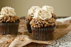 toffee crunch cupcakes with chocolate ganache and caramel swiss meringue buttercream