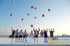 A Sand Key Beach Wedding • Beach Balls.  P.L. Carrillo Photography. http://gulfbeachweddings.com/ - http://plcarrillophotography.com/