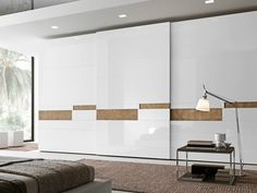 Sectional lacquered wardrobe with sliding doors SPLIT by Presotto Industrie Mobili design Pierangelo Sciuto