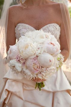 Romantic pink peonies are so stunning against a strapless blush-tone wedding gown. #WeddingBouquet