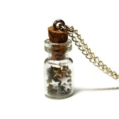 Bottled Dreams Necklace. I used to have one of these with flowers in it back in the 70's.
