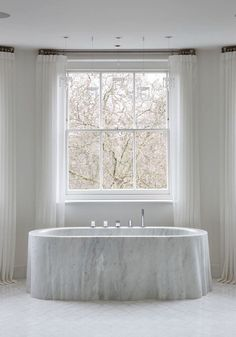 Chesney's hand-carved marble bathtub. Elle Decor September 2015