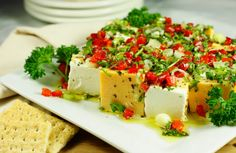 Yummm, gotta try this out. The Kitchen is My Playground: Marinated Cheese {Party Series 4}