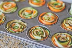 Vegetable Spiral Mini Tarts Recipe Repeat until spirals are formed in cups. Season with additional salt & pepper, if desired, to taste. Brush some vegetable oil on the tops of each cup. More from my site One-Pot Creamy Tomato Tortellini Soup Recipe Vegetable Appetizers, Vegetable Dishes, Spiral Vegetable Recipes, Vegetable Spiralizer, Vegetable Ideas, Tart Recipes, Cooking Recipes, Vegetable Tart, Mini Tart