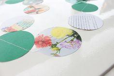 Zelfgemaakte slinger van oude flow tijdschriften! www.webshop.littledeer.nl #slinger #flow #tijdschriften #ponsen #DIY #creatief #inspiratie