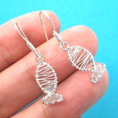 A pair of sterling silver fish shaped wire wrapped dangle earrings! They are made in the shape of a fish and are simple, cute and allergy free! For more sea themed animal jewelry please visit our stor