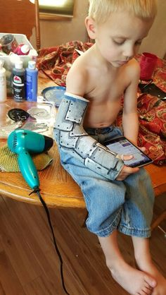 Painted my son's cast to look like sheet metal and rivets