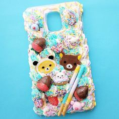 This case is not a normal case. I don't normally do copyrighted characters but a friend of mine really wanted to me to do this for her.  #panda #cabochon #decoden #resin #pocky #donut #rilakkuma #catscatscats #korilakkuma #whippedcream #chocolatechipcookie #icecreamcone #phonecase #sugarcookie #polymerclay #スイーツデコ #cakeicing #sweetsdeco #cakemaking #neko #queequeg #icing #frosting #bakery #アイシングクッキー #クッキー #kawaii #kawaiicase #cakeart #foodart