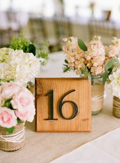 wood blocks with house numbers for table numbers. Love this idea!