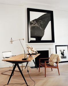 RIGHT ANGLES Baron's office displays photographs by Steven Klein amid classic modernist furnishings by Jean Prouvé (the Compas Direction table), Hans Wegner and Marcel Breuer (the chairs) and Édouard-Wilfred Buquet (the desk lamp).