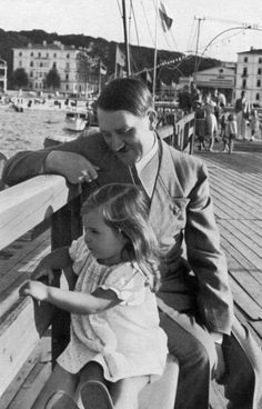 Adolf Hitler with Helga Goebbels. Helga was killed by her parents in the Berlin bunker as the Nazi empire crumbled. Poor little thing :(