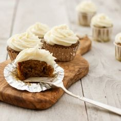 Pumpkin cupcakes with cream cheese frosting.  A great Thanksgiving treat!