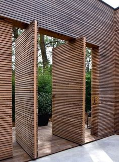 Pivot Doors Made Of Wood Louvers   Idea For Entry Gate For Increased  Security Of Courtyard