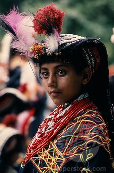 SuperStock - Pakistan, North West Frontier, Bumburet, Young Kalash Girl Wearing Traditional Dress At The Chilimjusht Festival In Bumburet