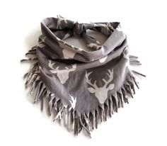 Tan Buck Bandanna Fringe Bib These fringe bandanna scarf bibs are absorbent and soft which is great for your every day drool. Moms can't say enough good things about these bibs! They are made of 100% designer jersey knit on top and bottom. The best part of this bandanna bib scarf is that its super stylish and can be worn as an accessory to your child's outfit.  Product Details:the size of these scarves are for children 0-3 years old.They are a one size fits most size up to age 3 years old.
