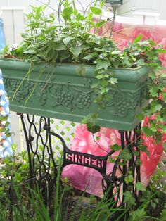 Repurposed Singer Sewing Machine base with planter - a creative idea for adding character to a vertical garden.  <3 this! More ideas @ http://themicrogardener.com/clever-plant-container-ideas/ | The Micro Gardener