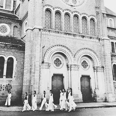 #Vietnamese #girls in traditional dresses walk by Notre Dame Cathedral Basilica of Saigon Ho Chi Minh city. South #Vietnam.  Photo & caption by @nasonphoto. ____ by ig_vietnam