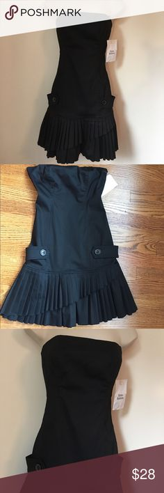 "MODA INTERNATIONAL BLACK STRAPLESS DRESS SIZE 0 New Super cute dress perfect for a party or night out.  Hidden zipper in back, drop waist with a pleated asymmetrical skirt. Size: 0. Measurements flat across Chest: 14"" waist: 12"" hips: 15"" Length: 27"" Moda International Dresses Mini"