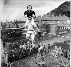 Harold Alzana (born Harold Davis) practicing with his sister, Elsie, in their backyard in South Yorkshire, England. Harold Alzana was a star fixture in the late 40s through the mid 60s with Ringling Brothers and Barnum and Bailey.
