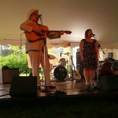 """Brandee Simone and Ryan Quinn of the Salvation Alley String Band sing """"Misery Pines"""" at the Green River Festival 2013."""