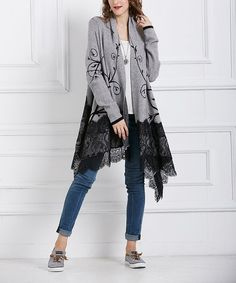 A lacy hem adds a pop of feminine style to this flowing open cardigan.