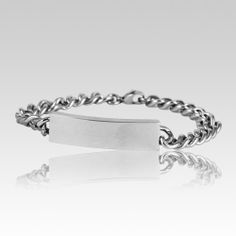 The Male Cremation Ashes Bracelet is stainless steel and is crafted by an artistic skilled jeweler one at a time. The quality is excellent and the craftsmanship is outstanding. This Keepsake Pendant holds a small amount of remains, a piece of hair or something that is small enough to memorialize your loved one and bring them close to your heart.  Screw opening under the chamber.