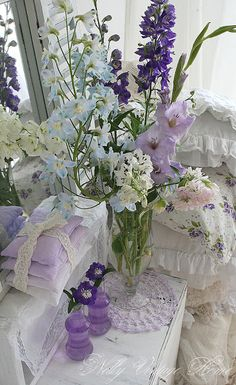 """Nothing quite says """"spring"""" like florals in soft pastel shades of blue, violet and pink. Here they're complemented with feminine laces, colored glass and frilly linens. 