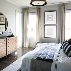 Light grey bedroom with brass accents | Leslie Cotter Interiors