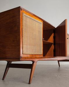 Detail view of Martin Eisler's credenza in rich caviona wood with a cane front, designed in the #1950s.