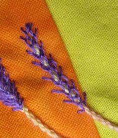 The stitch of TAST week 3  is feather stitch, you can find it here . I decided to create a sort of lavender.   First I embroidered the stem...