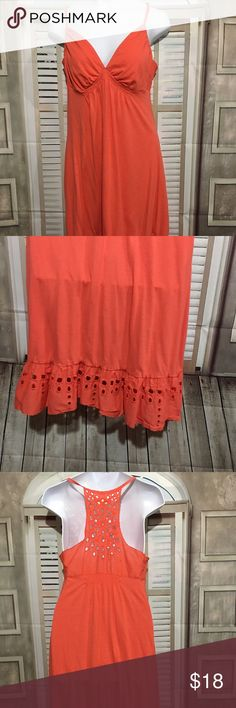 American Eagle Summer Dress Junior Small American eagle summer dress junior size small salmon color.  has cutout design along bottom and on top in back v- neck, spaghetti straps Previously owned.  gently used.  no flaws.  Material & approximate measurements: Material: cotton seam to seam under arms: 12 inches  length measured in front from top of shoulder to bottom near side seam: 35  inches (straps included in this measurement) length measured in back middle from top to bottom: 32 inch(does…