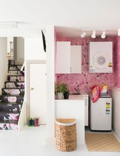 Wallpapered staircase and laundry. Flamingo and flowers what a statement