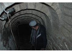 """Une cave-refuge du 17° siècle à Thiant - On apercoit la structure trés particulière de la voute de l'escalier de descente dite """"en redans"""". Cette structure est typique des constructions souterraines dans la région au 17° siècle."""